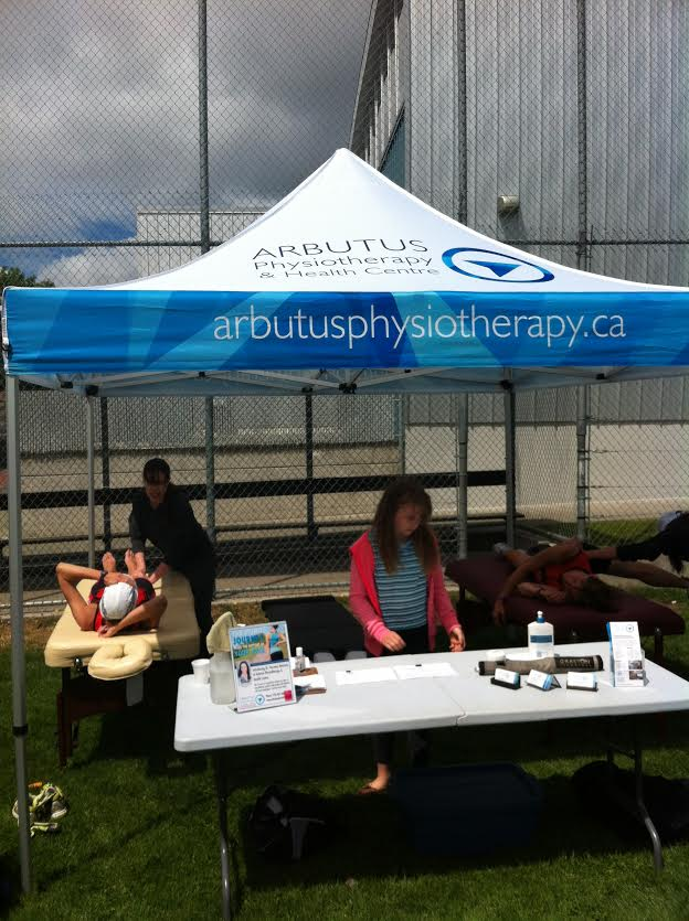 Dr. Hewstan and Rosie Chamberlin treating patients under the Abrutus Physiotherapy & Health Centre tent at the Victoria Youth Triathlon