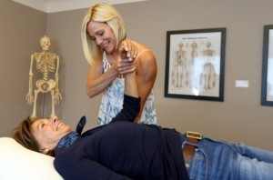 Physiotherapist Sandy Wilson treating patient Hana Kinsman