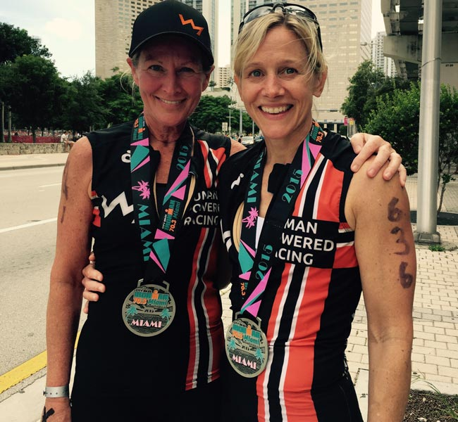 Sand and Debbie pose after the Miami 70.3 Ironman triathlon