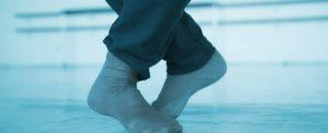 Socked feet poised to leap on the dance floor