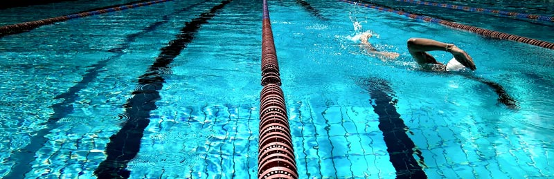 A swimmer does laps in the early morning