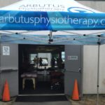 The Arbutus tent outside of the Garden City Invitational pavilion where Sandy Wilson and Kristen Bradley helped out.