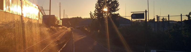 The sun sets over the rail road tracks in Vicoria BC