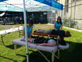 Kristen and Libby providing treatments to athletes at the Triathlon of Compassion 2016
