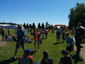 Athletes and supporters milling around at the Triathlon of Compassion