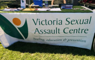 The Victoria Sexual Assault Centre table at the triathlon