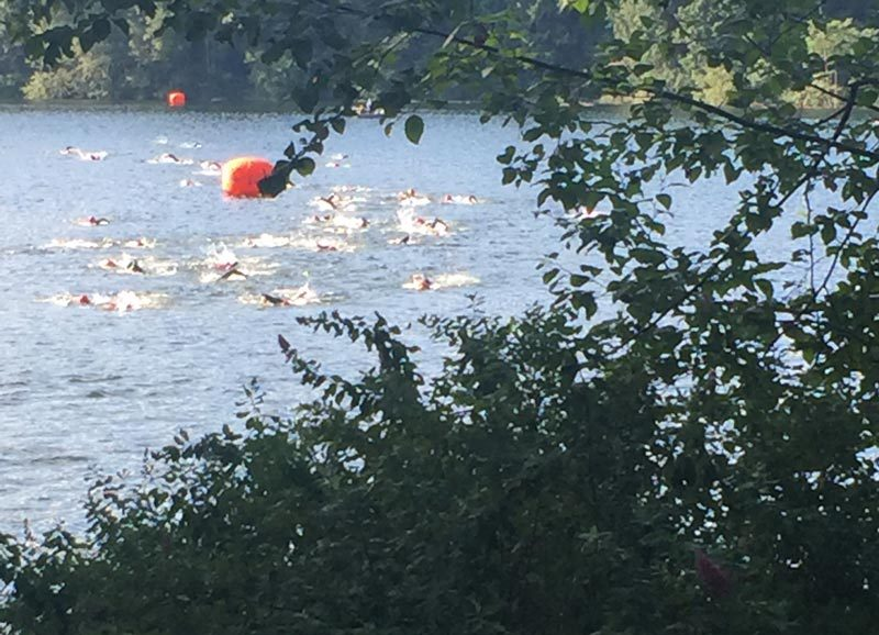 Swimmers make their way across Durrance lake