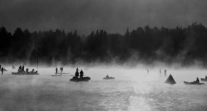 The fog rises off the water in the early morning of the Whistler 70.3 Ironman Triathlon