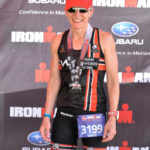 Sandy Wilson with her medal at the Whistler Ironman Triathlon 70.3