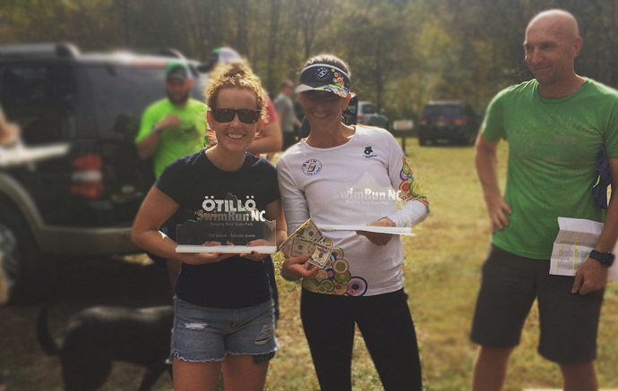 Misty Becerra from Florida and Sophia Chadwick pose with their first place trophy at the SwimRun in North Carolina