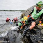 Swimmers climb out of the frigid Baltic Sea during the ÖTILLÖ SwimRun