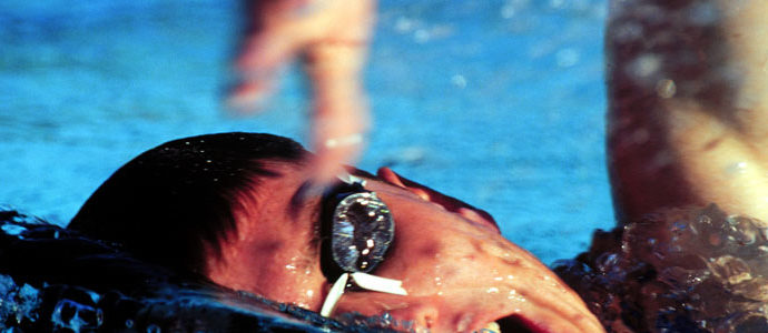 A swimmer breathes between strokes