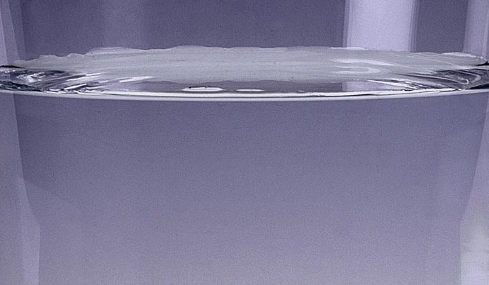 A still clear glass of pure water. Water is life.