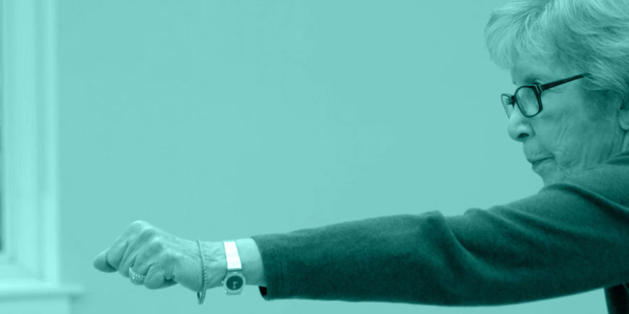 A woman lunges with a punch during a tai chi movement