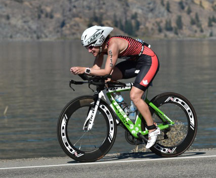 Sandy Wilson, physiotherapist, on the bike during the Penticton Triathlon 2017.