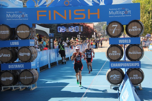 Sandy Wilson crosses the finish line at the ITU triathlon in Penticton.