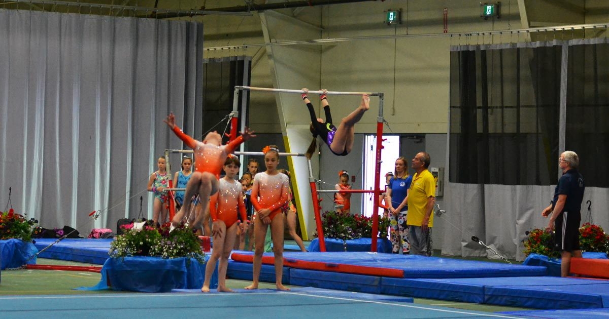 Gymnastics athletes from Edmonton compete on the floor and on the uneven bars.