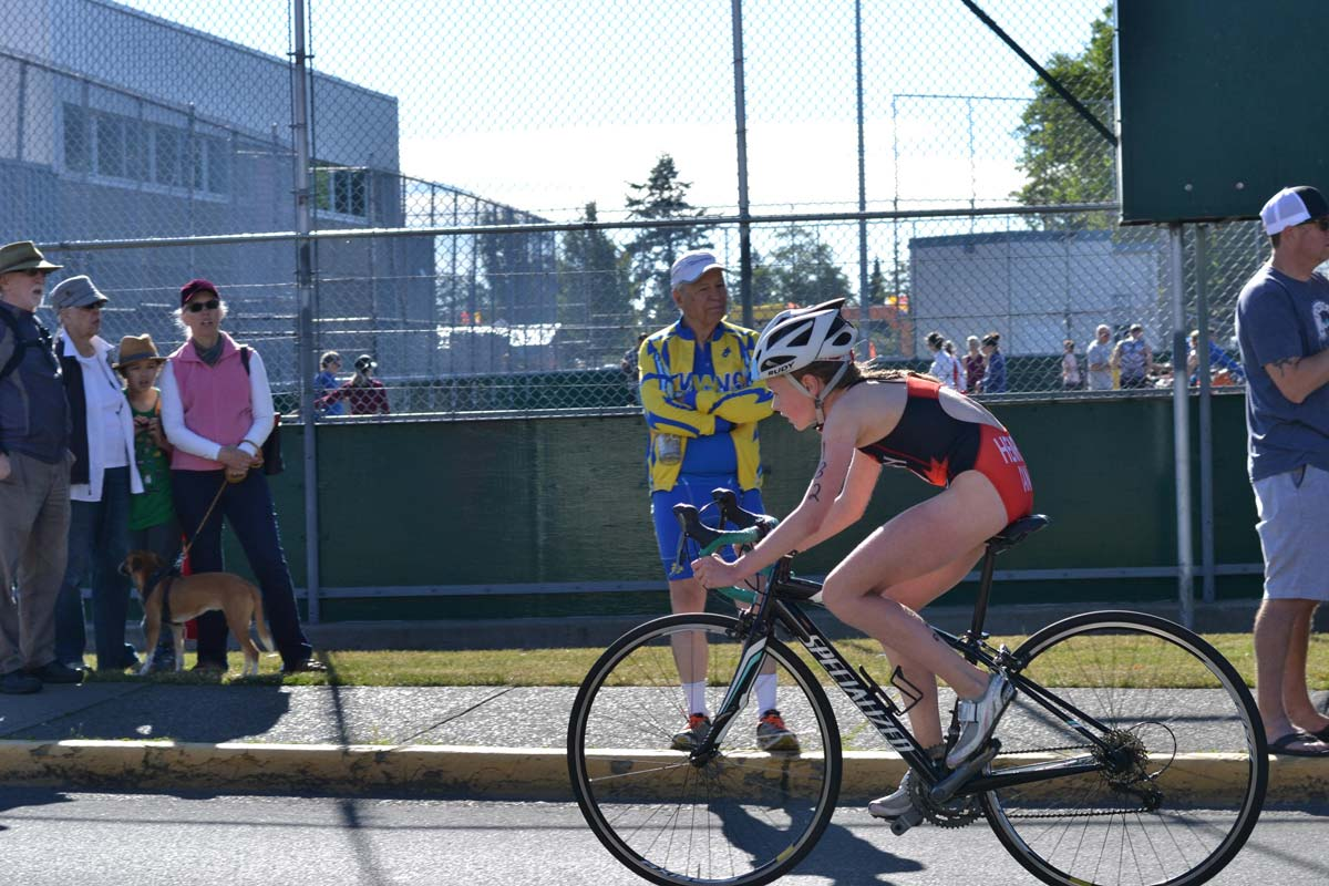 A cyclist races by the Esquimalt Recreation centre.