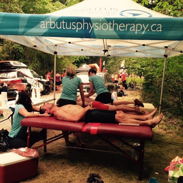 Arbutus physio blue and white massage tent outside for XTERRA event.