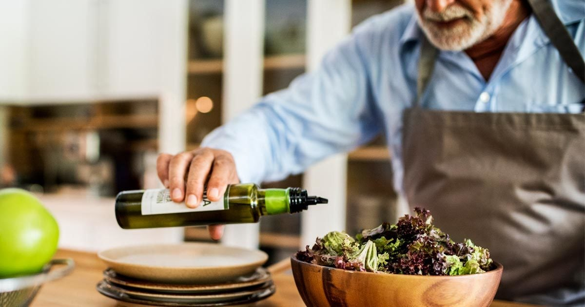 Old guy pours olive oil over his dressing!