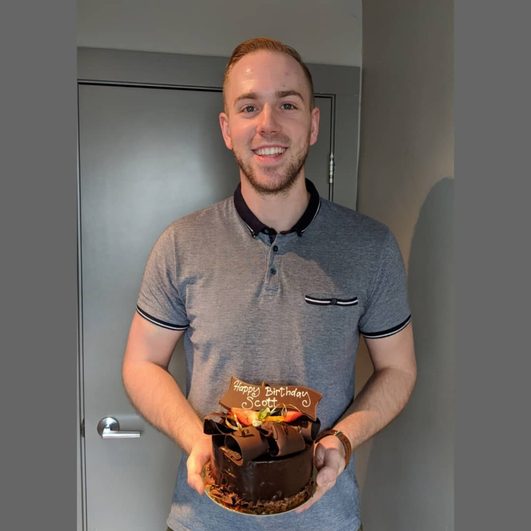 This picture is of Scott holding his chocolate cake.
