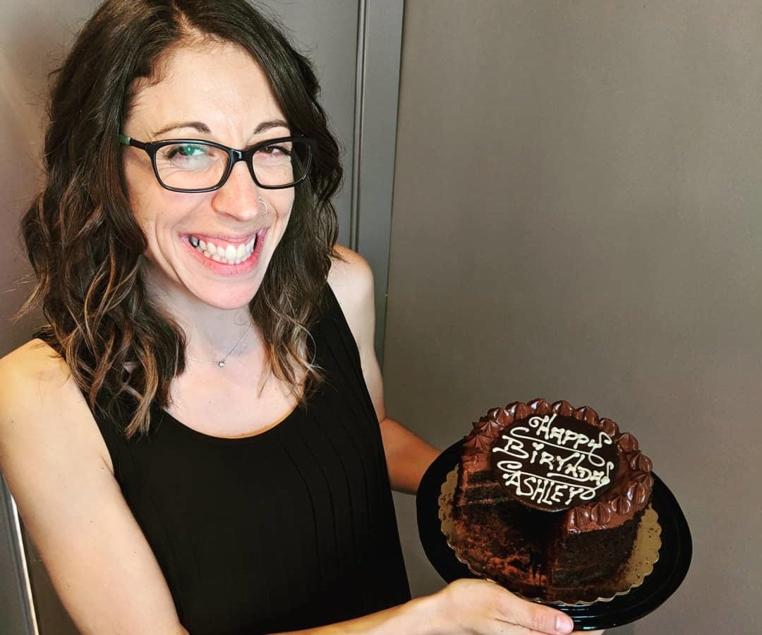 This shows Ashley holding her chocolate birthday cake.