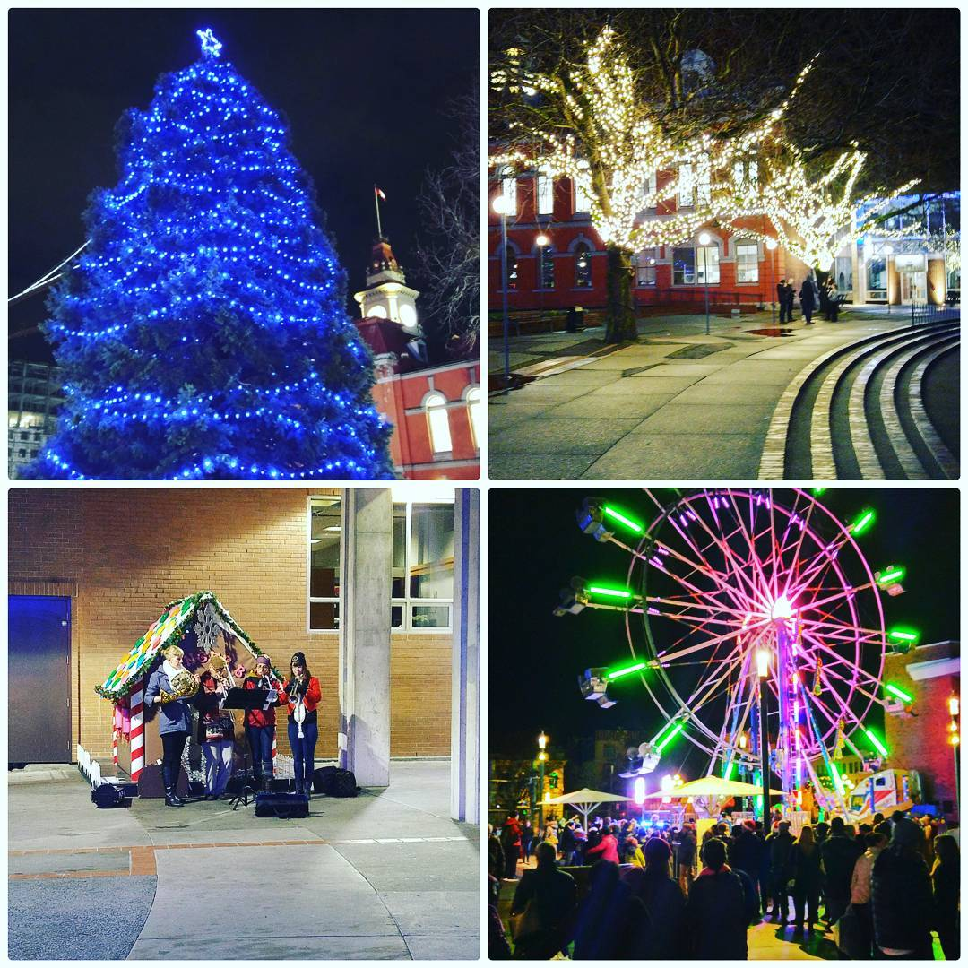 This is a photo divided into quarters, and each quarter is a different photo. The top left is a blue christmas tree outdoors at night, the top right is a street with yellow/white light on trees and night, the bottom left is a prop of a little red and green house outside with four people dressed up playing instruments, and the bottom right is a pink and green lit up ferris wheel at night.