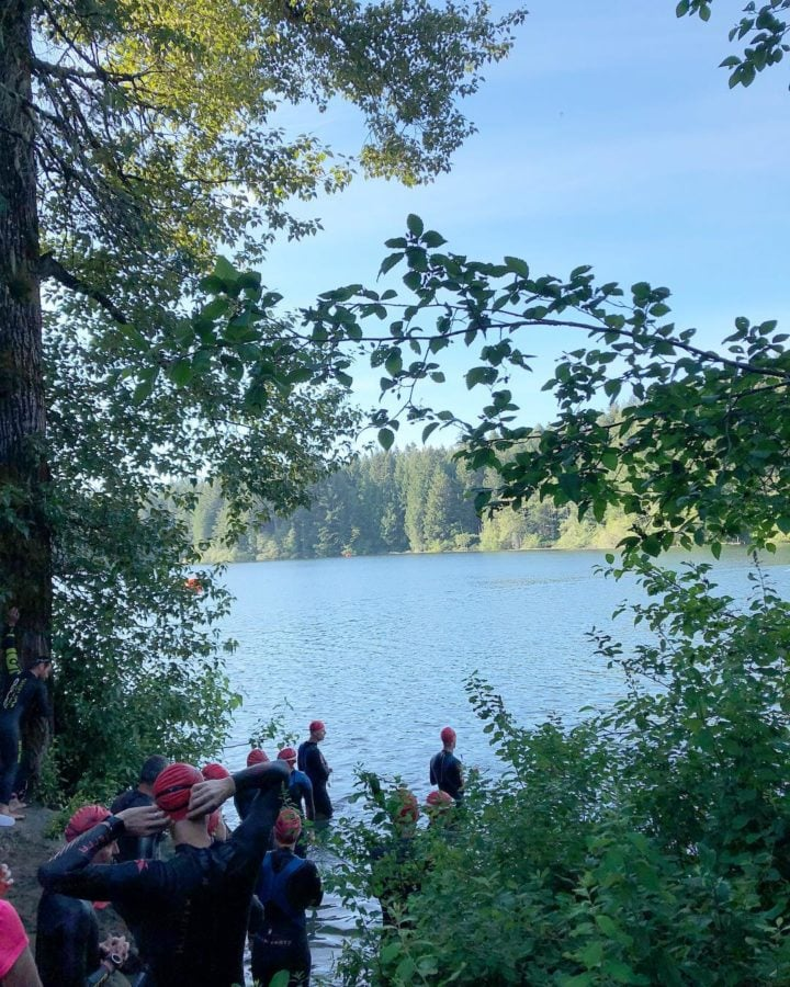 Racers at XTERRA Victoria dive into the water at Thetis Lake.