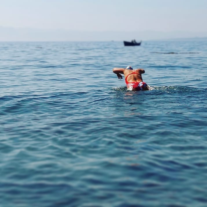 Susan Simmons dives into the water on Dallas Road to start her attempt to double cross the Juan de Fuca.