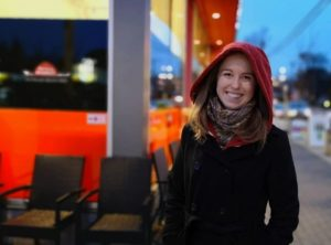 Olivia put her hood up as the rain starts on Oak Bay Ave, beside Red Barn.