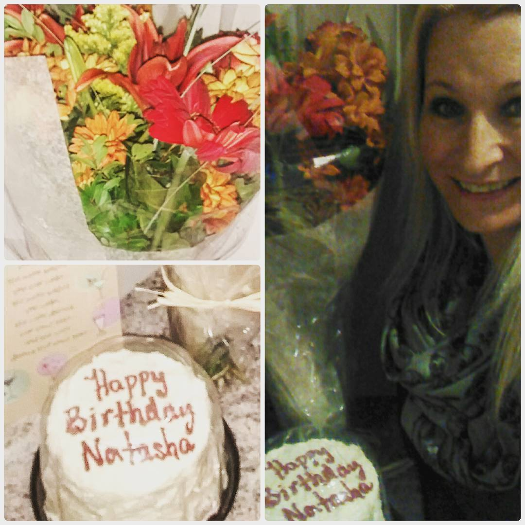 "This is an arrangement of three photos. The tall one that takes up the full right side is of a smiling woman with long blonde hair who is standing next to a white cake that says ""Happy Birthday Natasha"" in red icing, and a bouquet of red, yellow, and orange flowers. On the bottom left is a close up of the cake, and on the upper left is a close up of the bouquet."