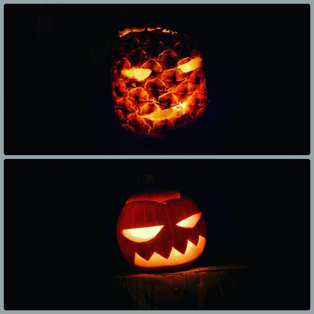 This is two photos stacked on top of each other. The top one is a carved pineapple lit up in the dark with two eyes and a smiling mouth. The bottom is a pumpkin lit up in the dark with two eyes that are straight on top and curved on the bottom and spiky teeth.