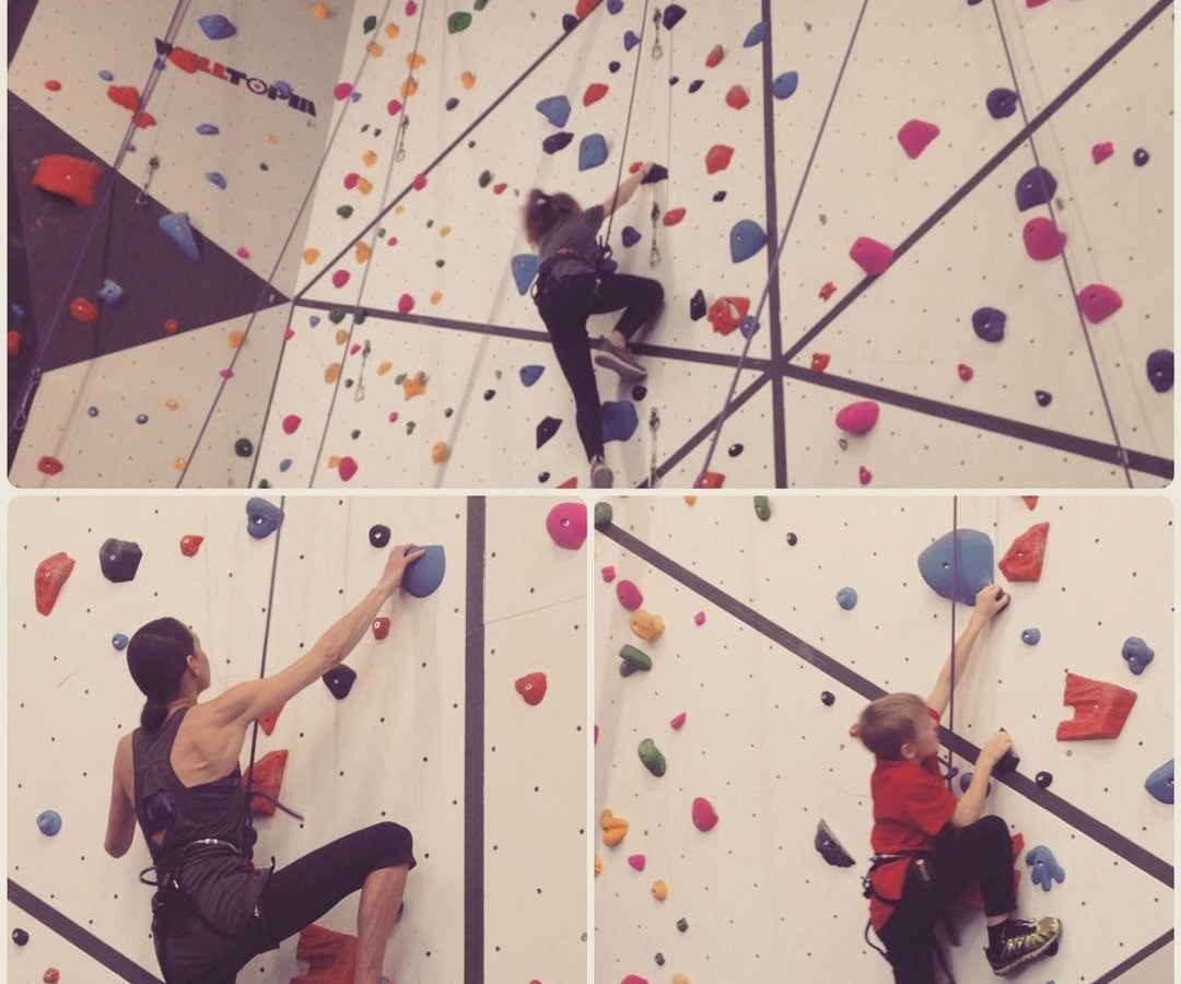 There are three photos here, and they all show individuals climbing a white wall attached with harnesses and ropes, with red and blue handholds. The top one and the one on the bottom left show adult women. The bottom right shows a young boy in a red tshirt.