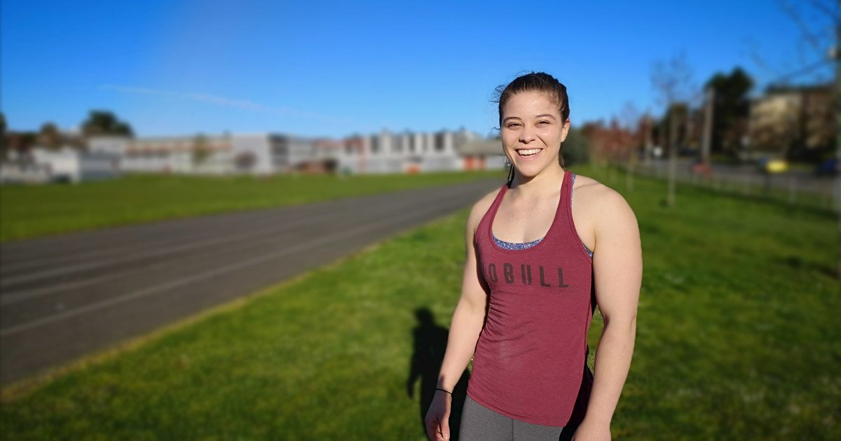 Brooke Woodley stands in the field at Esquimalt High School on a sunny bright West Coast day.