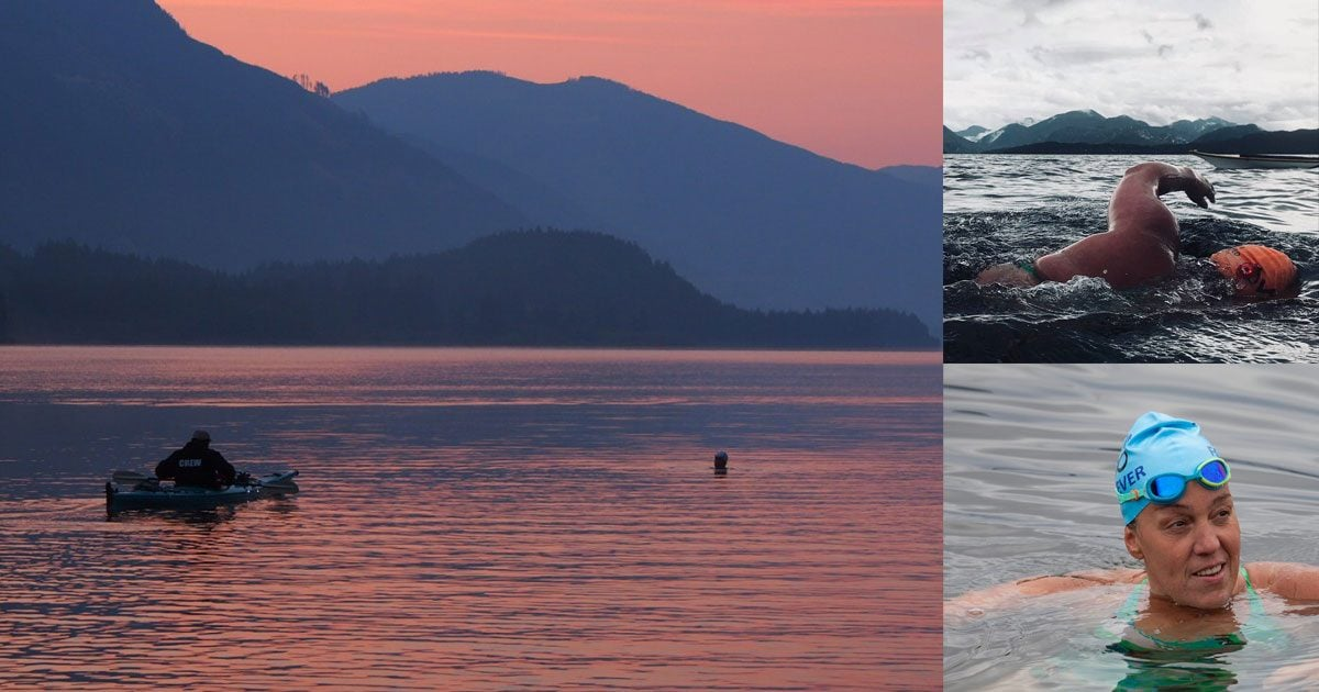 """The sky and water are pink with the sunset, and the mountains in the distance are various shades of blue. A person in a """"crew"""" jacket paddles a boat to the left and Susan's head is visible above the water to the right."""
