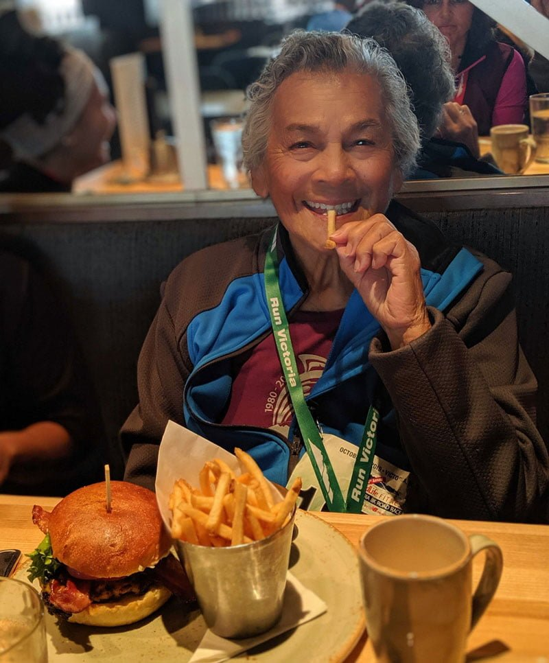 Stephanie Holbrook's nana has a burger and fries after the Victoria Marathon.