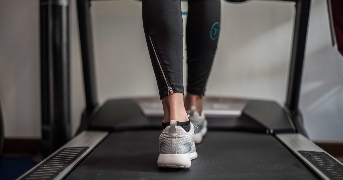 A person walks on a treadmill in preparation for athletic testing.