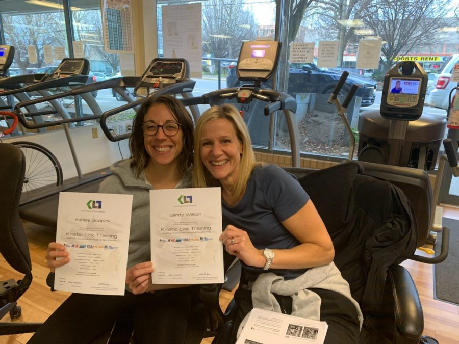 Ashley Scopick and Sandy Wilson pose with their certificates at Kinetic Link Training.