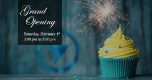 Grand Opening celebration on February 1st, Saturday, with a cupcake in the foreground.