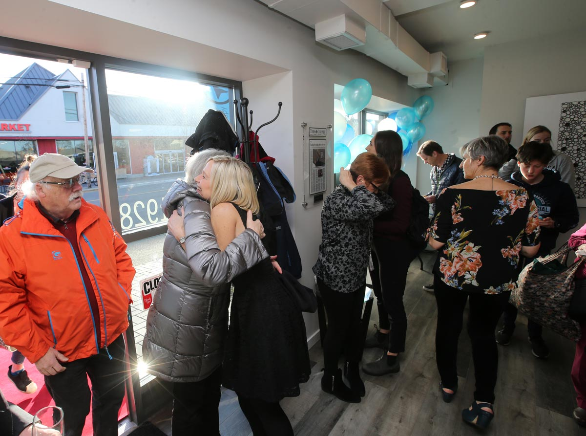 More hugs at the grand opening.