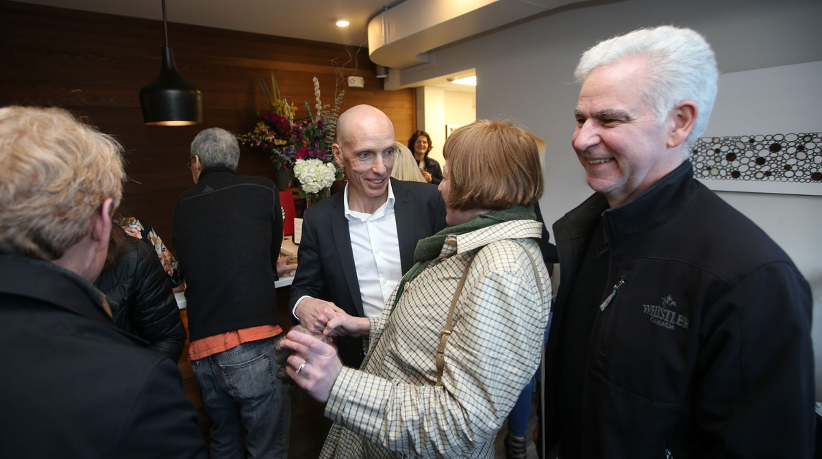Family and friends gathering at Arbutus for the grand opening.