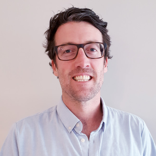 Profile photo of Andrew Mills, Physiotherapist, with his glasses on.