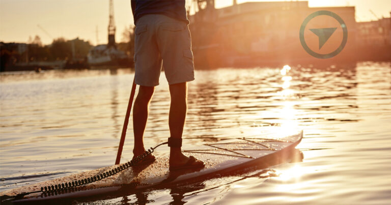 A paddler stands on a paddle board in the late afternoon light of the Gorge in VicWest.
