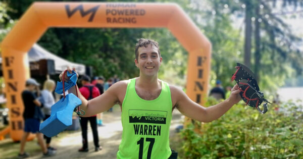 Brandon Warren poses with his SwimRun gear at the finish line of SwimRun Victoria.