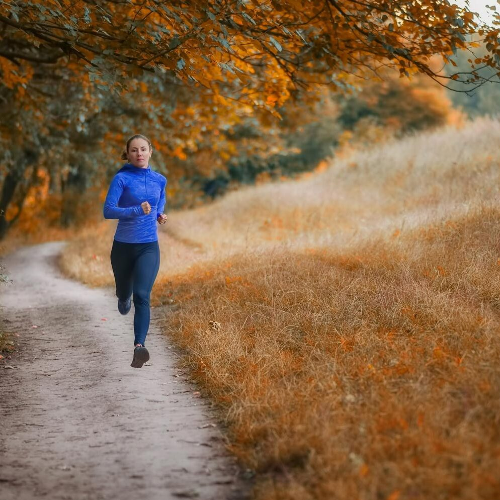 A runner moves along a path on Vancouver Island.