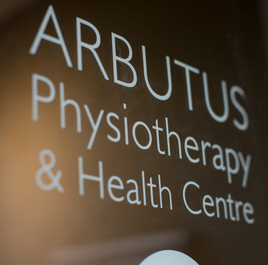 """Glass door with """"Arbutus Physiotherapy & Health Centre"""" written on it"""