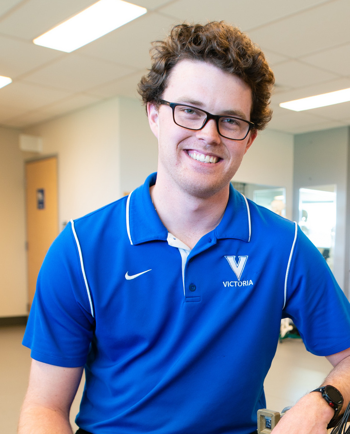 Isaac Davies smiles at a gym facility on the campus of the University of Victoira.